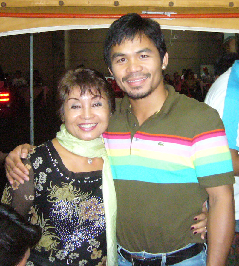 "Boxer ""Pacman"" Manny Pacquiao and Florencia from FloWer Beach"